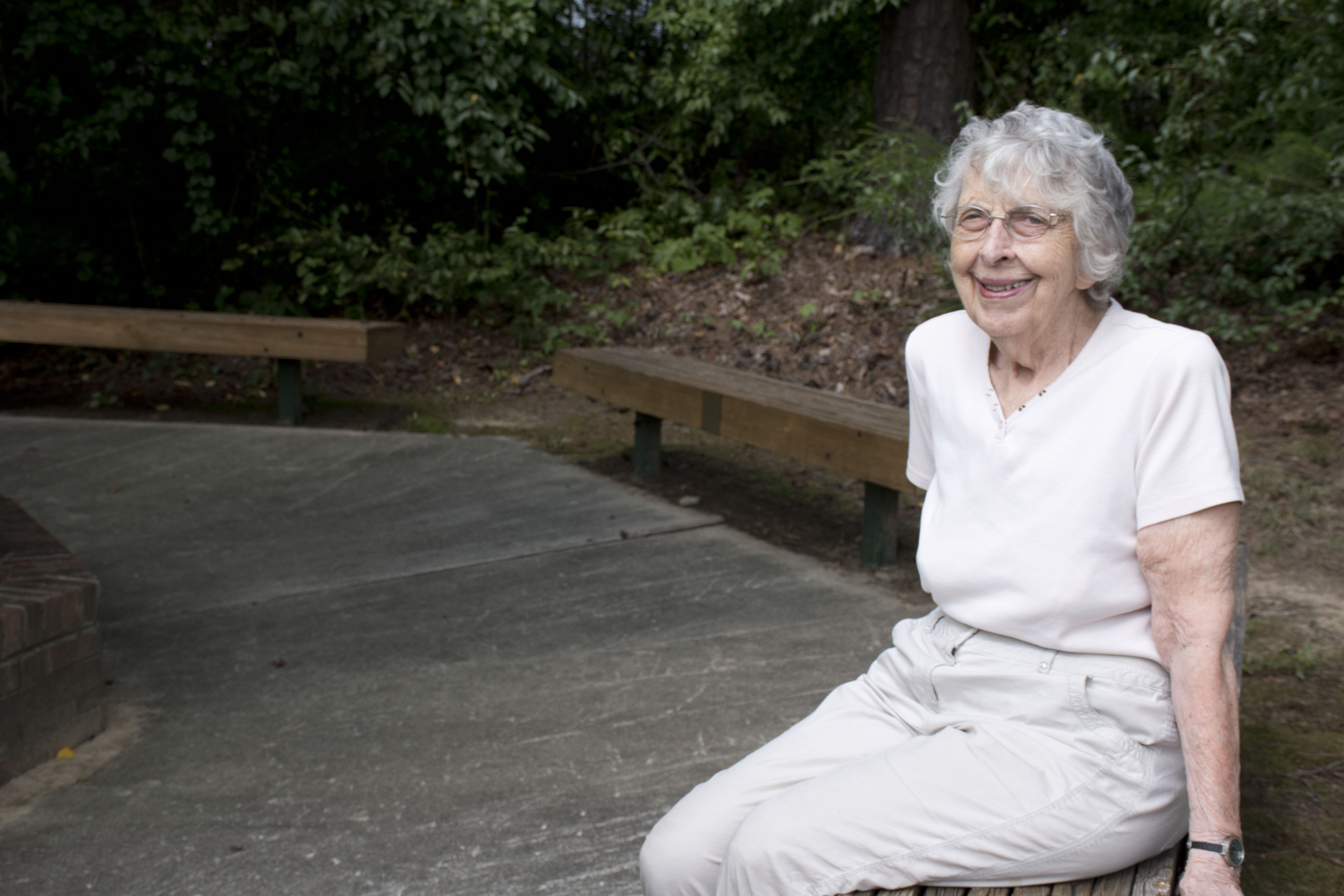 Older woman sitting outdoors